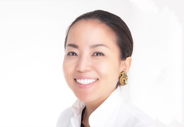 Headshot of Dr. Shoko Sato in a white shirt