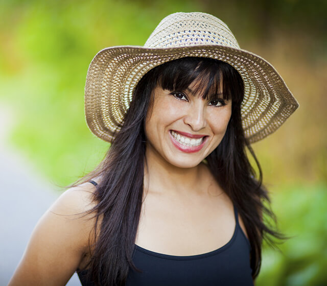 Woman in a sun hat smiling