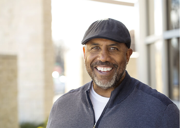 Portrait of a man in a cap with a big smile