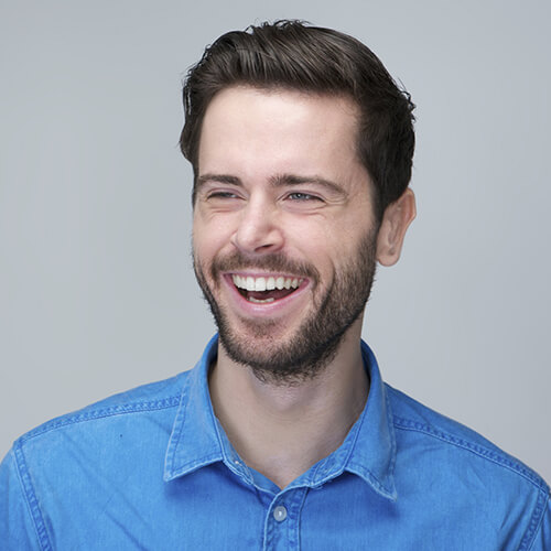 Man in a blue shirt smiling