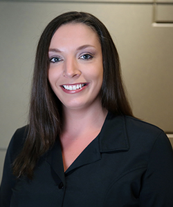Headshot of Carli, a dental assistant