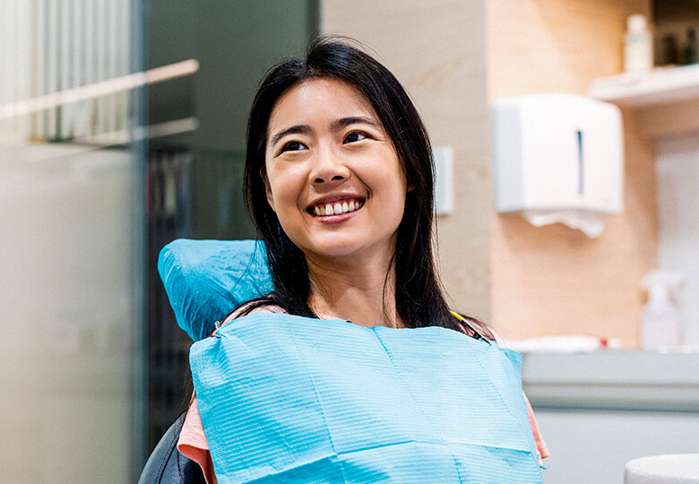 Young woman smiling in a dental chair