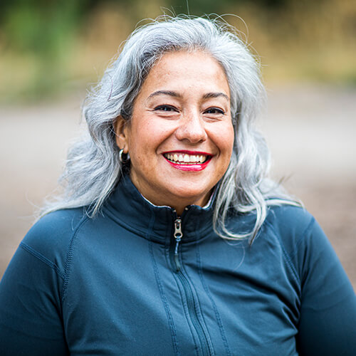 Mature woman smiling in a windbreaker