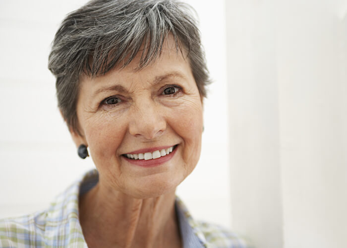 Close up of an older woman with a beautiful smile