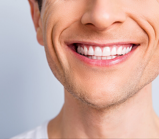Close up of a man's straight smile