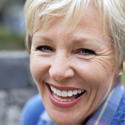 Close up of an older woman with a big smile