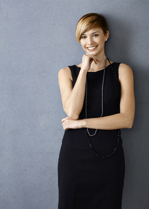 Young woman in a black dress smiling
